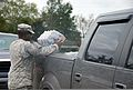 A U.S. Soldier with Bravo Company, 199th Brigade Support Battalion, Louisiana National Guard (LANG) distributes ice to citizens in need of resources after Hurricane Isaac in the Venetian Isles section of New 120902-A-SM895-017.jpg