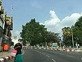 A Woman crossing road Yangon downtown.jpg