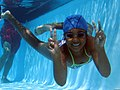 A child smiles for the camera underwater while participating in the Marine Corps Community Services' annual Splashin' Olympics at Marine Corps Base Camp Pendleton, Calif., Aug 110804-M-MC155-003.jpg