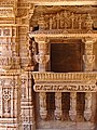 A open window with heavily decorated stone panels, Adalaj stepwell.jpg