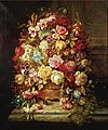 A still life with flowers in a jardiniere resting on a ledge by Hans Zatzka.jpg