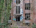 Abandoned military building with someone looking by the window in Fort de la Chartreuse, Liege, Belgium (DSCF3383).jpg