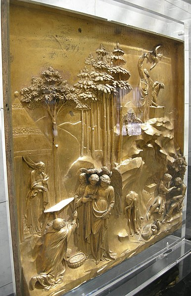 "Side view of Lorenzo Ghiberti's cast gilt-bronze ""Gates of Paradise"" at the Florence Baptistery in Florence, Italy, combining high-relief main figures with backgrounds mostly in low relief."