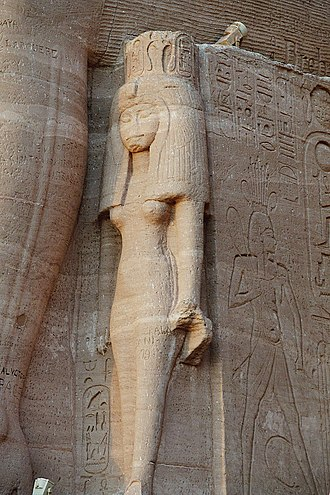Nefertari - Nefertari beside a colossus of RamessesII