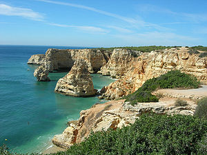 Praia da Marinha (English: Beach of the Navy) ...