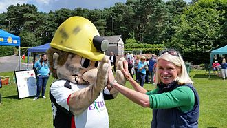 Amanda Milling - Amanda Milling MP with the mascot of Hednesford Town FC.