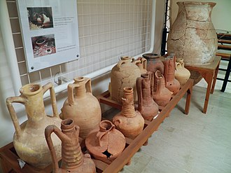 Brand - In pre-literate society, the distinctive shape of amphorae was used to provide consumers with information about goods and quality. Pictured: Amphorae for wine and oil, Archaeological Museum, Dion