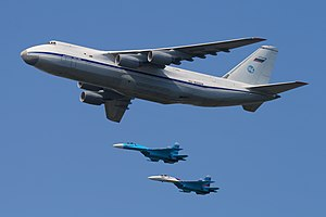 2010 Moscow Victory Day Parade - Antonov An-124 of 224th Flight Unit with 2 Sukhoi Su-27s of the Falcons of Russia aerobatic team.