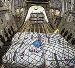 An RAF C17 aircraft is loaded with aid from the British people, headed for people affected by the earthquake in Nepal (16669794524).jpg