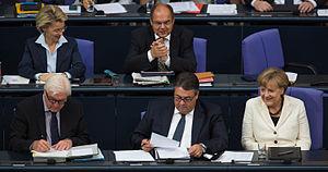 Sigmar Gabriel - Sigmar Gabriel with Angela Merkel and Frank-Walter Steinmeier; in the background are Christian Schmidt and Ursula von der Leyen, 2014.