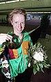 Anne Quinn holding Barcelona 1992 Paralympic medal.jpg