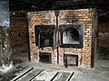 Auschwitz - gas chamber (10901307583).jpg