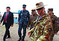 Australian Army Maj. Paul Manoel, right, the operations officer for U.S. forces during Khaan Quest 2013, leads Mongolian and U.S. military leadership into the exercise command operations center at Five Hills 130803-M-MG222-005.jpg