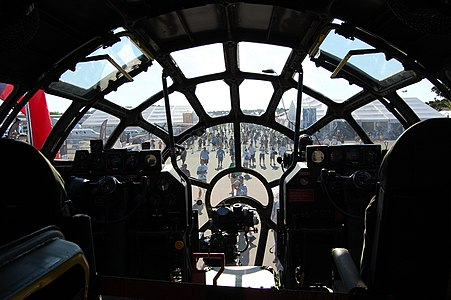The cockpit of Fifi, the world's only flying Boeing B-29 Superfortress. This image is looking outwards at EAA's AirVenture 2011, showing the view obtained from the array of windows of the aircraft.