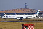B-HXG - Cathay Pacific - Airbus A340-313X - Oneworld Livery - PEK (12657614494).jpg