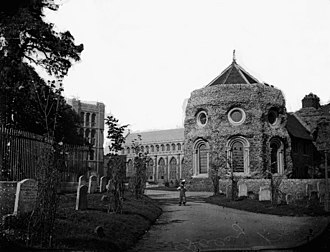 Bury St Edmunds Abbey - View of churchyard and (L-R) Norman Tower, St James Church and SW Tower of Abbey, c. 1920