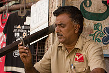 Bangalore blue collar guy on cellphone 2 November 2011 -34.jpg