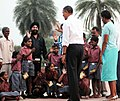 Barack Obama and the First Lady Mrs. Michelle Obama interacting with the school children of traditional artisans who carried out renovation works at Humayun Tomb, during their visit at Humayun's Tomb, in New Delhi.jpg
