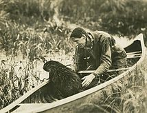 Grey Owl in a canoe.