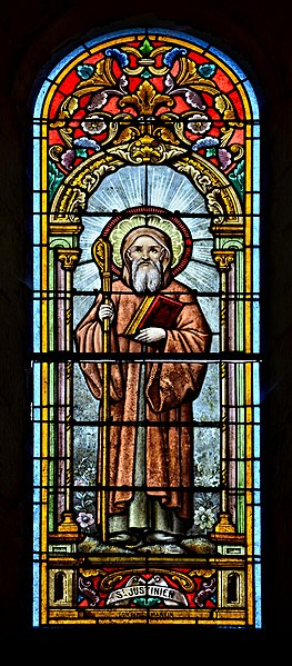 Stained glass window (ca 1900) depicting Saint Justinien, patron saint of the church of Benest, Charente, France