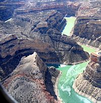 Aerial view of river winding through a steep canyon
