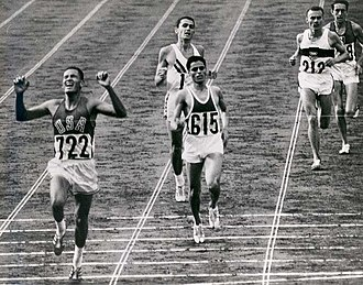 Billy Mills - Billy Mills breaks the tape in the 10,000 m in the 1964 Olympics.