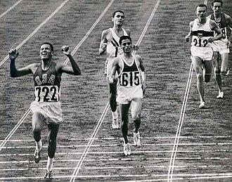 Ron Clarke - Image: Billy Mills Crossing Finish Line 1964Olympics