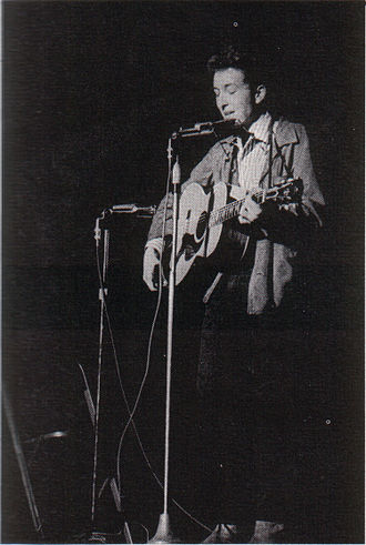 Electric Dylan controversy - Fans were used to seeing Dylan perform alone, with acoustic guitar and harmonica (1963)