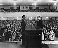 Branham stands before a crowd at a campaign appearanced, as seen in A Man Sent From God, 1950.jpg