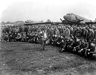 Anthony McAuliffe - Brigadier General Anthony C. McAuliffe, artillery commander of the 101st Airborne Division, gives glider pilots last-minute instructions in England for Operation Market-Garden on September 18, 1944, before the take-off on D plus 1 of the operation.