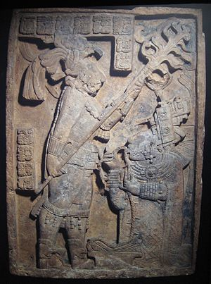 Bloodletting in Mesoamerica - Lintel 24 at Yaxchilan, depicting  Lady Xoc drawing a barbed rope through her tongue.