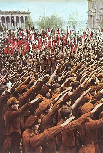 Indoctrination - Hitler Youth members performing the Nazi salute at a rally at the Lustgarten in Berlin, 1933