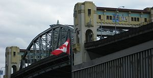 Burrard Bridge - Oblique view from northwest (Kitsilano) quadrant, showing existing change of line between central and approach spans, relative to deck grade-level, 'outrigger', cantilevered widening plan