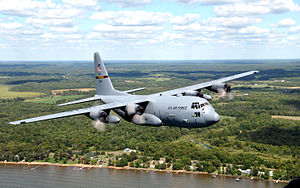 Minnesota National Guard - A 133rd Airlift Wing Minnesota National Guard C-130H flies along the shore of Mille Lacs Lake in northern Minnesota during a training mission. U.S. Air Force Photo by Tech Sgt Erik Gudmundson (Released)