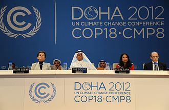 2012 United Nations Climate Change Conference - President of the conference Abdullah Bin Hamad Al-Attiyah (center) and Executive Secretary Christiana Figueres (left) at COP18