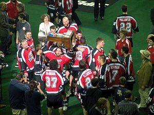 Calgary Roughnecks - Devan Wray hoists the Champion's Cup as the Roughnecks celebrate the 2009 championship.