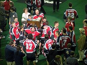 Champion's Cup - The Calgary Roughnecks raise the Champion's Cup in celebration of their 2009 championship.