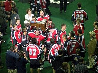 Calgary Roughnecks - Devan Wray hoists the Champion's Cup as the Roughnecks celebrate the 2009 championship.