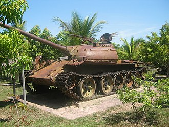 Cambodian Civil War - A memorial to the civil war in Siem Reap, Cambodia, with a rusted wreck of a Soviet-built T-54 main battle tank used during the war. Large numbers of T-54s were used by Cambodia during and after the bloody fighting of the conflict between 1970 and 1975, with many of such wrecks (in various states of abandonment and disrepair) scattered all over the country today.
