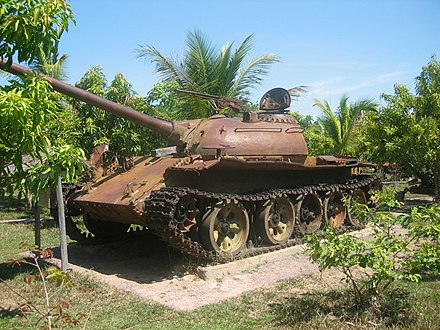 A memorial of a T-54/Type 59 tank in Siem Reap, Cambodia, commemorating the overthrow of US/RVN-backed Lon Nol and the end of the civil war by the NVA and GRUNK Cambodian Civil War-era T-54 or Type 59.jpg