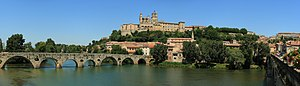 View of the cathedral of Béziers and of the old bridge over the Orb