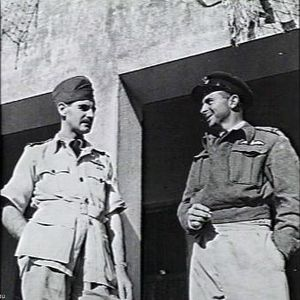 Charles Crombie - Wing Commander J. O'Neill congratulates Crombie on his success in destroying two Japanese bombers and damaging a third in one action over India.