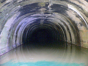 Church Hill Tunnel - Inside the east entrance to the tunnel, in  2010. The floor is under several inches of water. The far wall, where the tunnel is sealed off, is barely visible.