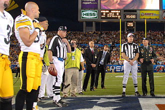 Super Bowl XLIII - Gen. David Petraeus talks with head Super Bowl XLIII Referee Terry McAulay prior to the coin toss.