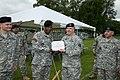 Col. Robert S. Larsen, U.S. Army NATO Brigade Commander, presents Command Sgt. Maj. Phillip L. Dixon, Supreme Headquarters of Allied Powers in Europe (SHAPE) Battalion, the Meritorious Service medal, before 130523-A-BD610-016.jpg