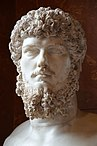 Colossal head of Lucius Verus (mounted on a modern bust), from a villa belonging to Lucius Verus in Acqua Traversa near Rome, between AD 180 and 183 AD, Louvre Museum (23450299872).jpg
