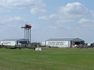 Saskatchewan Highway 16 - Large roadside scene. Combine on pole along the Yellowhead Highway at Elstow