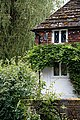 Cottage and garden wall in Nuthurst village, West Sussex, England 1.jpg