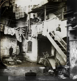 "Baxter Street - Jacob Riis ""Court at No. 24 Baxter St"" (1888; a rookery near the Five Points intersection) is an illustration of the squalor of 19th century slums"