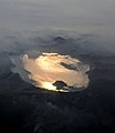 Crater Lake Oregon aerial with sun and clouds.jpg